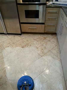 A tile cleaning in process showing the difference before and after cleaning.